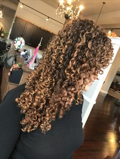 Corkscrew Curly Hair with Balayage Highlights