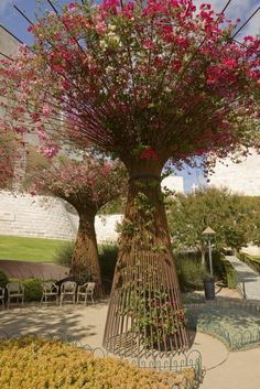 Trees made of rebar filled with bougainvillea in  the Central Garden at the Getty Center