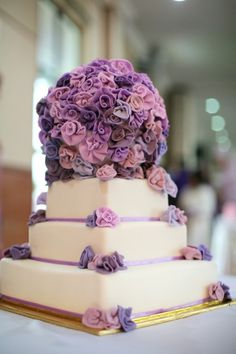 Pretty wedding cake with luxurious purple flowers