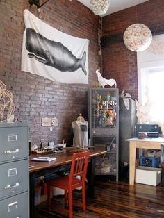 Exposed brick, metal, and a giant whale print. Excellent.