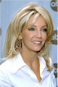 Heather Locklear has her hair long and thick. Her hair is layered ...