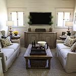 living rooms - Sherwin Williams - Accessible Beige - wood lamps beige walls vintage media cabinet topiaries linen wingback sofas jute rug wood coffee table greige pillows