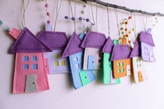 Set of eight felt houses in pastel colors, Housewarming gift, Home Decor.  Felt House decoration for all seasons.  Different and fun ornaments for your room or your kids. Decoration for wall hanging as well. Decorative art for children. House measures aproximate: 3.5 - 5 (9 cm - 15 cm)  Hanging measures aproximate.: : 7 - 9 (18 cm-22 cm).  There may be slight variations in colors.