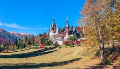 Autumn at Peles Castle - Overview of Peles Castle, Sinaia in autumn, with the peaks of Bucegi Mountains in the background