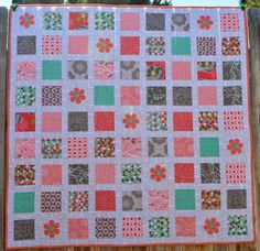 Happy Quilting: Cottage Stamp Baby Quilt and Tutorial * very cute quilt I love the addition of the applique flowers with button centers. Jelly Roll Quilt Patterns, Quilt Patterns Free, Cute Quilts, Baby Quilts, Strip Quilts, Quilt Blocks, Quilting Tutorials, Quilting Designs, Quilting Ideas