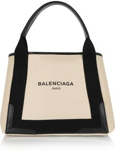 c071b09c18ee We love this leather-trimmed, cotton-canvas tote bag from Balenciaga. Shop