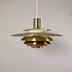 Danish Super Light from the 1970s. The lamp is a complete mid century vintage, as its shape, color choice and very Sven Middelboe-like look fits perfectly into a vintage home where you want classical Danish design. It is in good condition with common signs of age. There are some