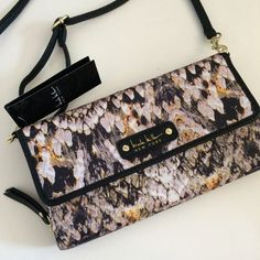 Nicole Miller mini crossbody! A stunning crossbody bag, almost built like a wallet.  Strap is detachable to easily convert to clutch or large wallet.  Love the colors and pattern.  So feminine and sophisticated.  Perfect bag! Nicole Miller Bags Crossbody Bags