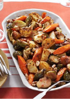 Roasted Winter Vegetable Trio — Opt for this flavorful side dish of Brussels sprouts, carrots and potatoes tossed in a zesty dressing.
