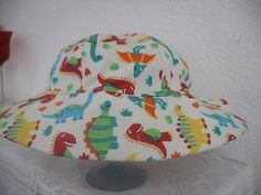fc932d6ba65 Dinosaur Infant And Toddler Sun Hat by sealedwithstitches on Etsy
