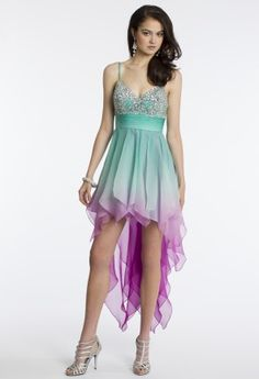 This gorgeous aqua to magenta ombré beauty. It has a beaded trim and a high-low hanky hem skirt. The hanky hem allows the dress to flow with graceful movement as you twirl along the dance floor. Heads will turn as you walk into the room of your prom or homecoming party or just a fab, chic event of any occasion. You will surely the prom queen title when you wear this exquisite dress! Showcase this look with an oval rhinestone handbag, glitter open toe pumps, and a crystal and rhinestone drop ...