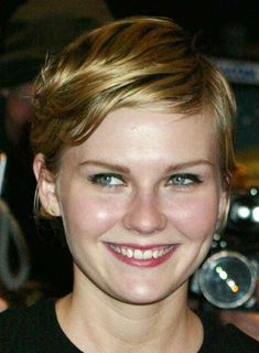 Kirsten Dunst's slick pixie works best for fine hair. To get her look: 1. Use a fine-tooth comb to style hair while it's wet and clean. While it's still wet, rake it with your fingers to create some chunky texture. Air dry. 2. When it's totally dry, add grooming cream (a pea size at a time) and style it into a chic, side-slicked look, bangs included. 3. To finish, spray your fingertips with hairspray and glide them along your bangs to help keep them in place.