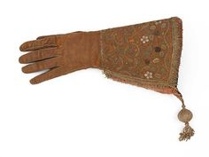 Falconry glove belonging to King James VI, leather embroidered in silk and silver, around 1600-20 Burrell Collection