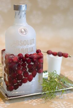 Fabulous for holiday party  Save and clean a square milk or orange-juice carton, and cut the top off. Put your favorite bottle of vodka inside. Add fresh cranberries and fill halfway with water. Freeze for at least four hours. When you're ready to serve, just peel off the milk carton and set your icy drink on a tray to catch the drips.