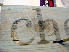 printed letters transfer to wood -- use 'rotate canvas' n photoshop to print word, wet paper on wood, press/scratch to transfer ink from paper to wood, use diluted paint to darken.