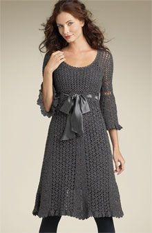 Crocheted dress.  Would love a pattern for something like this. Love the bell sleeves and satin bow.
