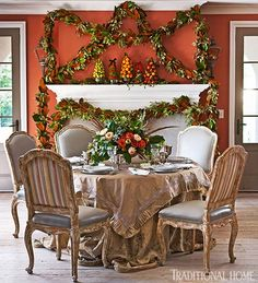 """Colorful fruit """"trees"""" are delightful on a holiday mantel.  - Traditional Home® / Photo: John Bessler"""