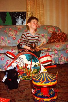 Christmas 1948 - The face of joy... Santa left a drum set, stuffed animal, and a…