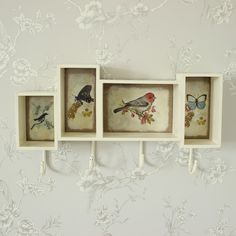 Birds and Butterfly Shelf Unit with hooks A cream painted shelf unit with four hooks, split into four compartments each with a bird and butterfly painted design with fixings to hang on any wall a quirky design ideal for any hallway £35.95 www.melodymaison.co.uk