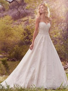 Check out one of Maggie Sottero's newest pieces from the 2017 line!  Reba - She has an ethereal a line skirt, lace appliques and a gorgeous sweetheart neckline.   Call us to come see our current offerings for Maggie Sottero! 817-437-2100
