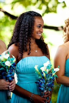 FBB15  Bridesmaids flowers blue small orchids, white calla lilies and wispy turquoise filler.