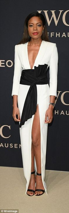 Monochrome madness: Later in the evening, Naomie emerged in an elegant two-tone dress...