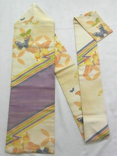 This is a vintage summer Nagoya obi with butterfly and 'shippou-tsunagi' (interlocking circles) on thunder pattern, which is dyed