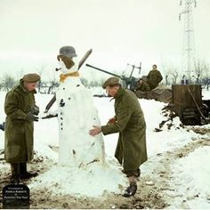 A British anti-aircraft crew build a snowman near their entrenched 40mm Bofors gun, somewhere in Italy, 6th January 1945. Pin by Paolo Marzioli