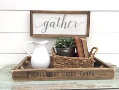 GATHER  This handmade, wooden, framed sign will be perfect for any kitchen, dining room or family room. It is painted in a distressed vintage white background with gray font. The frame, if chosen, is stained in warm, medium stain. A timeless piece that will lend itself to any decorating style.  Your sign will be painted then sanded and distressed to add character as well. Each piece will be clear coated in a satin poly for long-lasting durability, however, it is recommended for indoor…