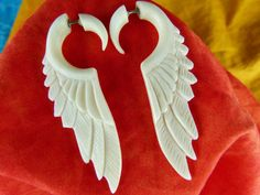 Even though there fake there still pretty sick Fake gauge white feather earrings Fake by TwoFeatherConnection