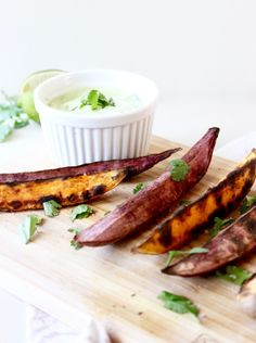 Grilled sweet potato wedges with avocado cream sauce for dipping are the perfect healthy side to accompany burgers and more! Healthy Side Recipes, Gluten Free Recipes Side Dishes, Yummy Vegetable Recipes, Healthy Side Dishes, Real Food Recipes, Vegetarian Recipes, Budget Recipes, Avocado Cream Sauces, Grilled Sweet Potatoes