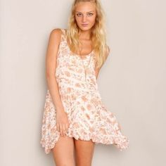 FP floral trapeze slip Adorable trapeze from free people! Size small. Great condition, worn only a couple times! Perfect for the upcoming summer Free People Dresses