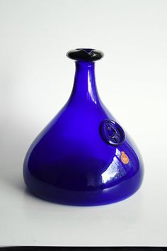Mid Century Cobalt Bottle Vase by Ole Winther for Danish glass manufacturer Holmegaard.