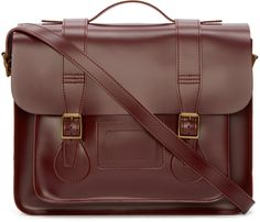 Structured polished leather satchel in cherry red. Brass-tone hardware. Fold-over flap at main compartment with pin-buckle fixtures. Removable adjustable shoulder strap. Carry handle at top. I.D. window at front face. Patch pocket at front face. Tonal stitching. Approx. 15