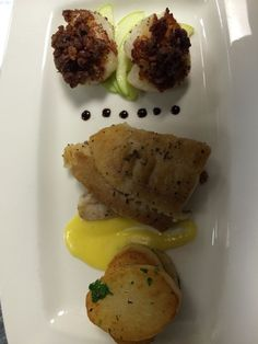 Seared tripletail with a black truffle hollandaise. Candied bacon crusted scallops and fresh herb roasted potatoes