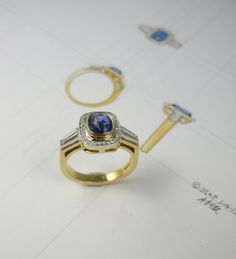 Sapphire set in yellow gold, surrounded by small diamonds
