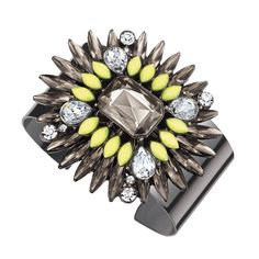 Watch admirers flock to you when you wear this fantastic feather design featuring a jolt of neon yellow against smoky and clear faceted crystals.While supplies last.