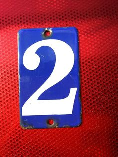VINTAGE ROUNDED OBLONG ROYAL BLUE AND WHITE ENAMEL ON IRON HOUSE NUMBER 2