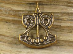 Torfin makes some of the finest Viking brass fittings and jewelry I've ever found, especially for those prices.  Ship Pendant  - Free shipping. $25.00, via Etsy.
