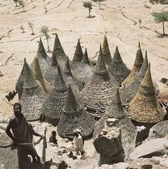 architecture Thatch-covered conical roofs of cylindrical houses in a Matakam compound, Cameroon. by Rene GardiThatch-covered conical roofs of cylindrical houses in a Matakam compound, Cameroon. by Rene Gardi Cultural Architecture, Vernacular Architecture, Gothic Architecture, Amazing Architecture, Interior Architecture, Historic Architecture, Organic Architecture, African Culture, African Art