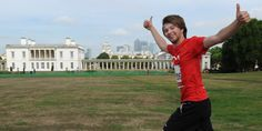 One BHF runner giving thumbs up in Greenwich park.
