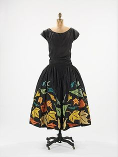 This 1924 robe de style has a DIY crafty vibe to it. I could see borrowing the motif of the tumbling leaves in autumn colors, and creating an A-line skirt with felted leaves.  And wearing it to work, which I could not do with the original.
