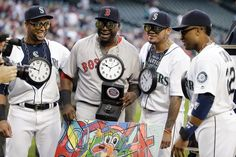 Boston Red Sox's David Ortiz, second from left, smiles for a group photo with Seattle Mariners' Nelson Cruz, left, Felix Hernandez and…