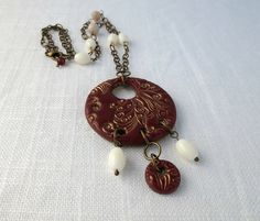 Oxblood polymer clay pendant accented with vintage glass beads