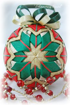 """""""Quilted"""" ornaments.  Made some last year, fun to make, used over 200 straight pins per ornament!"""