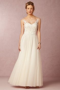View this collection of 25 beach wedding dresses and gowns perfect for a beach wedding!