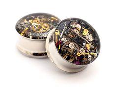 Steampunk Watch Parts Plugs gauges - 00g, 1/2, 9/16, 5/8, 3/4, 7/8, 1 inch. $19.99, via Etsy.