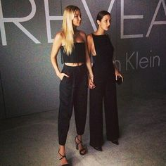 LEFT: crop top/strapless bralet, high waist pep trousers, strap heel sandals, long middle parting straight hair