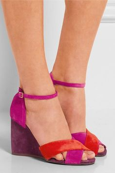 love the striking pink, red and purple hues of Lanvin's color-block sandals. They're crafted from velvety suede and finished with a slender wedge heel. Highlight yours with cropped pants.