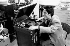 Nam June Paik demonstrates Listening to Music through the Mouth in Exposition of Music Electronic Television, 1963. Photo by Manfred Montwé.